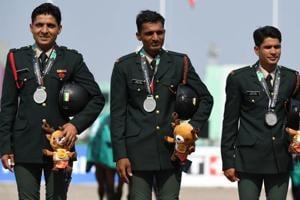 Ashish Malik, Jitender Singh, Rakesh Kumar and Fouaad Mirza stand on the podium at Asian Games 2018.