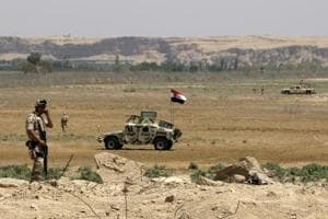File photo of Iraqi soldiers patrolling along the border between Syria and Iraq in Anbar province, Iraq.