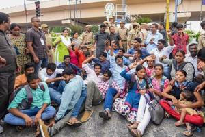 Police detain activists during a protest against the arrest of Varavara Rao and others, in Hyderabad on Wednesday.
