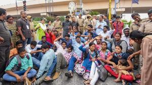 Hyderabad: Police detain activists during a protest against the arrest of revolutionary writer Varavara Rao and other activists in connection with Bhima-Koregaon violence, in Hyderabad on Wednesday.