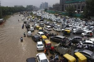 Traffic congestion due to waterlogging after heavy rains at Sector 10 in Gurugram on Tuesday.