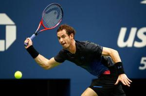 Andy Murray of Great Britain returns the ball during his men