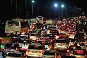 A spell of rain on Wednesday brought traffic to a crawl at Shankar Chowk.on National Highway-48.