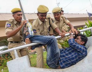 Police detain an activist during a protest against the arrest of revolutionary writer Varavara Rao in Hyderabad on Wednesday.