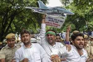 Police detain Indian Youth Congress (IYC) members during a protest against Rafale deal scam, at Akbar Road in New Delhi on Thursday, Aug 30, 2018.