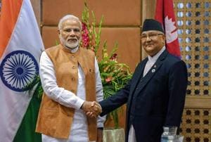 Prime Minister Narendra Modi shakes hands with Prime Minister of Nepal K P Sharma Oli at a meeting on the sidelines of the 4th BIMSTEC Summit, in Kathmandu on Friday, August 31, 2018.
