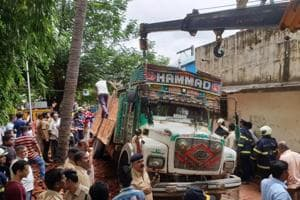 Central railway's public relations officer Sunil Udasi said that railway officials, fire brigade, ambulances and a crane were at the spot, while the BrihanMumbai Muncipal Corporation's disaster management cell said that five to six people are feared trapped under the bricks.