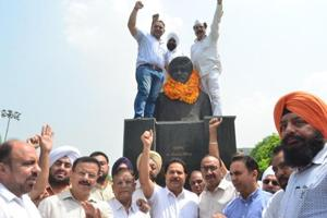 Punjab School Education Minister OP Soni with party leaders and workers paying homage to former Punjab CM Beant Singh on his death anniversary at Beant Singh Park in Amritsar on Friday.
