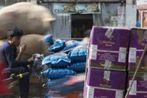 Workers transport goods at Khari Baoli spice market in New Delhi.