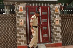 A policeman comes out of the house in Brijpura, Pataudi, where four members of a family were murdered on Wednesday.