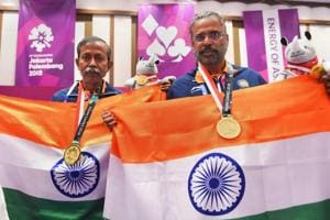 Gold medallist Pranab Bardhan and Shibhnath Sarkar pose with the Indian tricolour after winning in the bridge competition at the 18th Asian Games in Jakarta on Saturday.