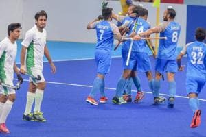 Jakarta: Indian hockey player Akashdeep Singh celebrates with teammates after scoring their first goal against Pakistan during the India-Pakistan bronze medal Men