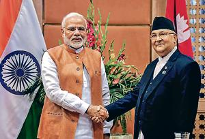 Prime Minister Narendra Modi shakes hands with his counterpart in Nepal, K P Sharma Oli, at a meeting on the sidelines of 4th BIMSTEC Summit in Kathmandu, Nepal, August 31, 2018