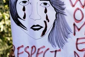 A protester holds up a placard against anti-women crimes in Delhi.