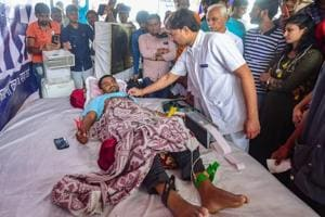 A doctor checks the health of Patidar Anamat Andolan Samiti (PAAS) leader Hardik Patel on the 7th day of his indefinite hunger strike, in Ahmedabad on August 31.