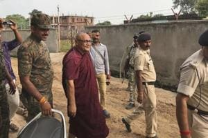 55-year-old monk Bhante Sangh Priya, a Bangladeshi national, is escorted by police after being arrested in Bodh Gaya, in Bhiar on Thursday.