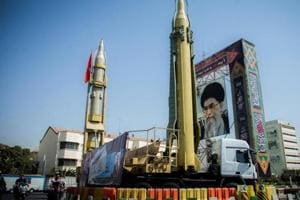 A display featuring missiles and a portrait of Iran