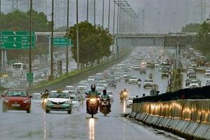 Commuters on the Delhi-Gurgaon Expressway on a wet Saturday. According to IMD officials, the city recorded 1mm of rainfall between 6 and 7.30am on Saturday
