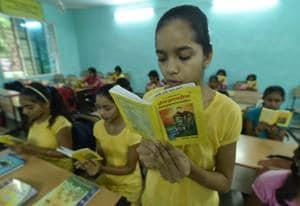 Students of Government Girls Sanskrit School, Bhopal reading Bhagwat Gita.  (Photo by Mujeeb Faruqui/Hindustan Times)