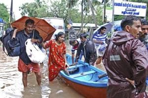 Flood victims are evacuated to safer areas in Kozhikode.
