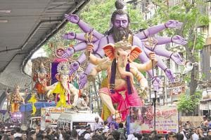 Devotees for different areas carry idols ahead of the Ganesh Festival, at Lalbaug.
