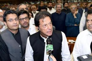 Imran Khan (C), chairman of Pakistan Tehreek-e-Insaf (PTI) political party speaks after he was elected as Prime Minister at the National Assembly (Lower House of Parliament) in Islamabad, Pakistan August 17, 2018.