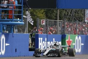 Checkered flag is waved as Mercedes driver Lewis Hamilton of Britain crosses the finish line during the Formula One Italy Grand Prix at the Monza racetrack, in Monza.