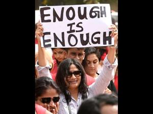 An activist holds a placard at a rally against sexual crimes across India (AFP File)