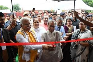 Former President Pranab Mukherjee along with Haryana Chief Minister Manohar Lal Khattar inaugurates a project during an event to commemorate the expansion of the Pranab Mukherjee Foundation's SmartGram initiative, in Harchandpur village, in Sohna, Gurugram, on Sunday.