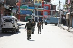 Soldiers stand guard near the house in which militants were killed after gunfight in Jammu and Kashmir.