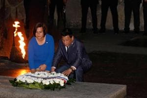 The President of the Philippines Rodrigo Duterte (R) and his daughter lay a wreath at the Hall of Remembrance on September 3 during his visit to the Yad Vashem Holocaust Memorial museum in Jerusalem.