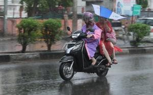 Commuters caught in rain in Jaipur. Heavy rain lashed Rajasthan's eastern districts in 24 hours, Met Department said Monday.