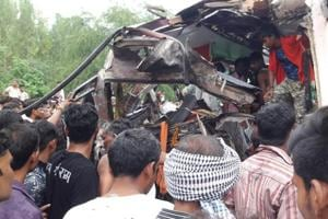 Crowds gather to see the remains of the buses involved in an accident near Aligarh on Tuesday.