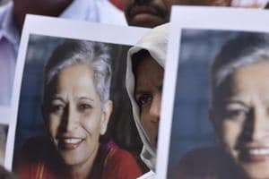 People stage a protest against the killing of Gauri Lankesh at Town hall in Bengaluru on September 6, 2017.