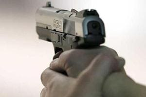 Police said two gunmen fired four rounds at the victim.