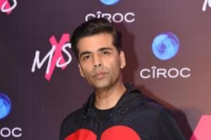 Bollywood film director-producer Karan Johar poses during the store launch of the fashion label MXS in Mumbai on September 1.