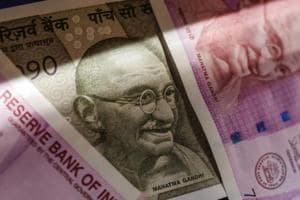 Two thousand and five hundred rupee banknotes are arranged for a photograph in Mumbai.