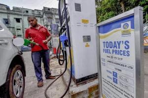 An employee fills a vehicle with fuel at a filling station, in New Delhi. Fuel prices continues to rise for the 10th day on Tuesday with petrol reaching Rs 79.31 a litre and diesel Rs 71.34.