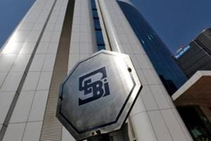 The logo of the Securities and Exchange Board of India (SEBI) is pictured on the premises of its headquarters in Mumbai.