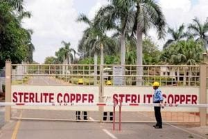 A security guard stands in front of the main gate of Sterlite Industries Ltd