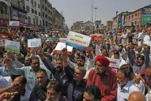 Kashmiri traders shout slogans during a protest against challenging the validity of Article 35A, in Lal Chowk, Srinagar on August 29.