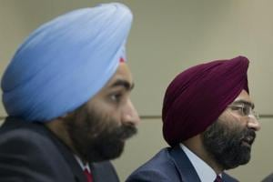Chairman of Fortis Healthcare Malivnder Singh (right) answers a question as his brother and managing director Shivinder Singh sits next to him during a news conference in Singapore in July 2010.