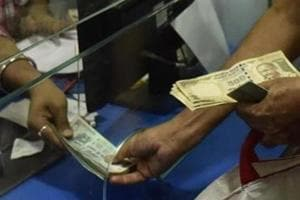 A man gets his old 500 rupees notes exchanged with 100 rupees at Canara Bank Ghatkopar (W) in Mumbai, India.