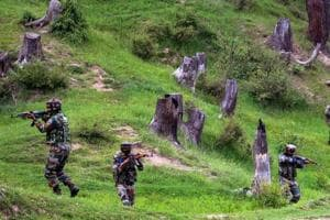 Army personnel take positions during an encounter with the militants in Keran Sector of Kupwara district of north Kashmir on June 10.