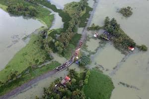An aerial view shows partially submerged road at a flooded area in the southern state of Kerala on August 19.