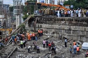 Emergency personnel during rescue operations after the bridge collapse at Majerhat.