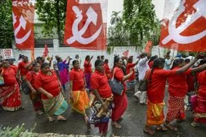 Workers and farmers of various unions raise slogans during