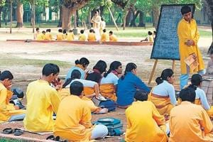 Students attend an outdoor class on the Visva-Bharati campus.