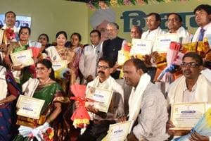 Deputy chief minister Sushil Kumar Modi with the teachers who were honoured on Teacher's Day, in Patna on Wednesday.