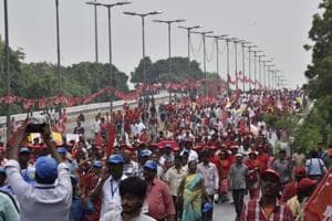 Over a lakh farmers and workers took out a protest march in the national capital to demand remunerative prices for farm produce, loan waiver and a minimum wage of not less than Rs 18,000 a month.